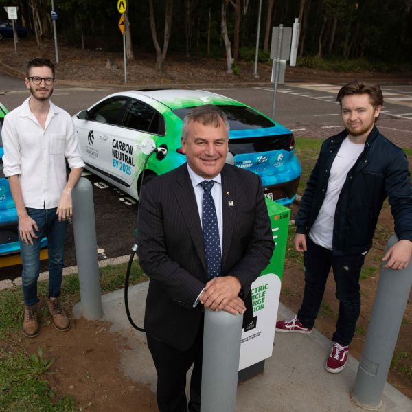 Students Connor Getley and Edward Clarkson with Vice-Chancellor Professor Alex Zelinsky with the electric vehicle charging station