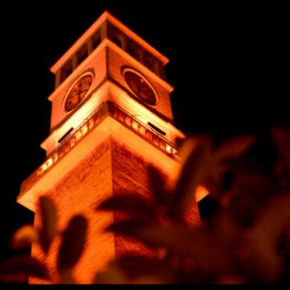 Clock tower lit up orange