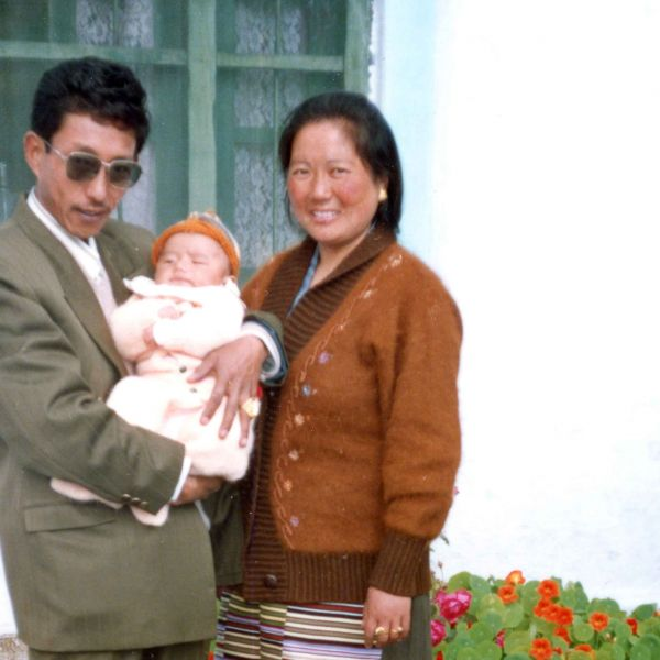 Tenzin and his parents in Dharamsala, state of Himachal Pradesh in India