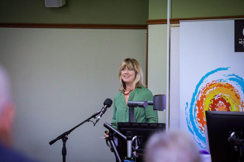Speaker addressing audience