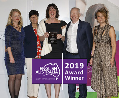 Staff receiving the English Australia Award for Innovation