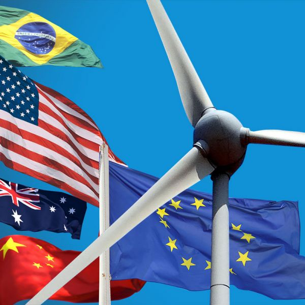 Country flags in front of wind turbine