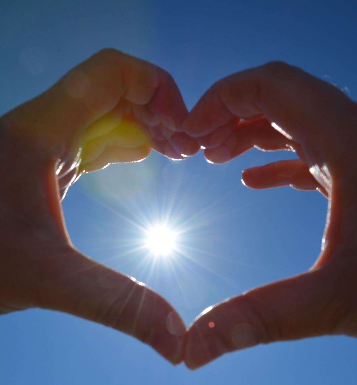 sun in hand heart