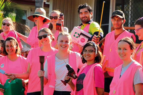 A group of volunteers in hi-vis gear