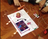Students interacting with makey makey technology