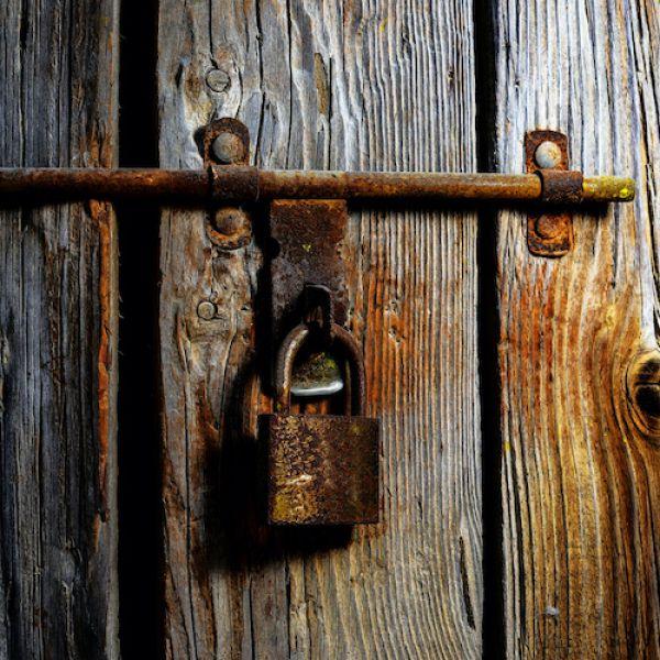 Old wooden door with padlock