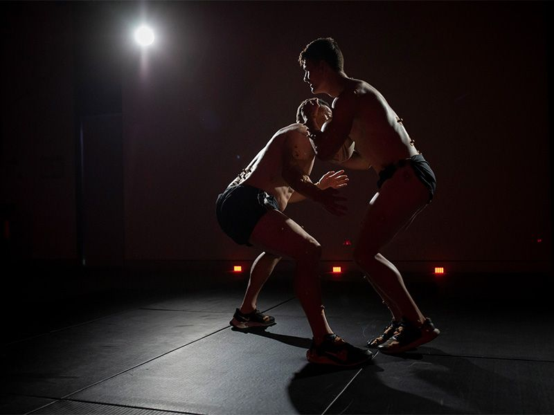 Timana Tahu and Exercise and Sports Science student Scott engaging in a tackle for the motion capture recordings