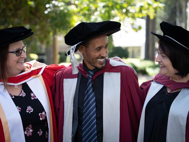 Teketo Tegegne with his PhD supervisors Professor Deb Loxton and Dr Catherine Chojenta.