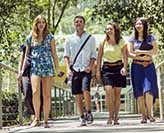 Students walking over a bridge on campus