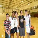 A nutrition and dietetics student manages a team at midnight basketball as part of our community engagement