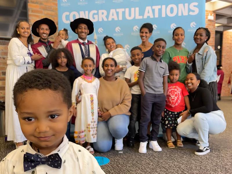 Teketo and fellow Ethiopian PhD graduate Kelemu Kibret celebrate with their family and friends.