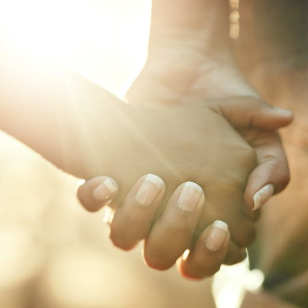 Stock image of holding hands