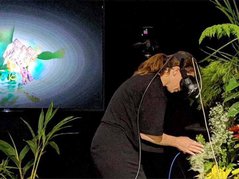 Dr Rewa Wright using virtual reality with plants