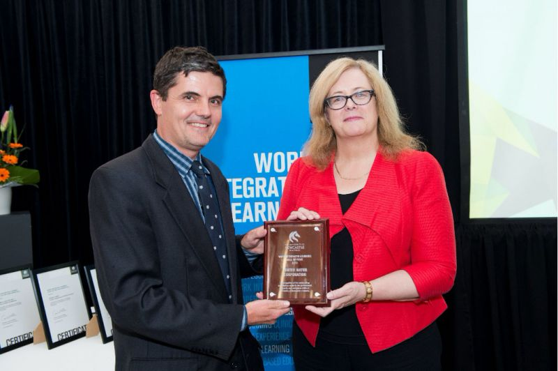 Jonathan Morris, Group Manager People & Safety, Hunter Water, receiving the WIL Hall of Fame Award from Vice-Chancellor and President, Professor Caroline McMillen