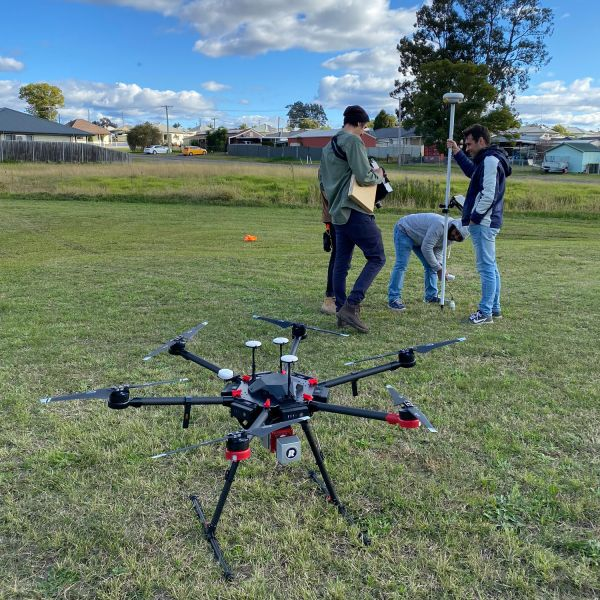 Researchers launching a drone with LiDAR remote sensing equipment