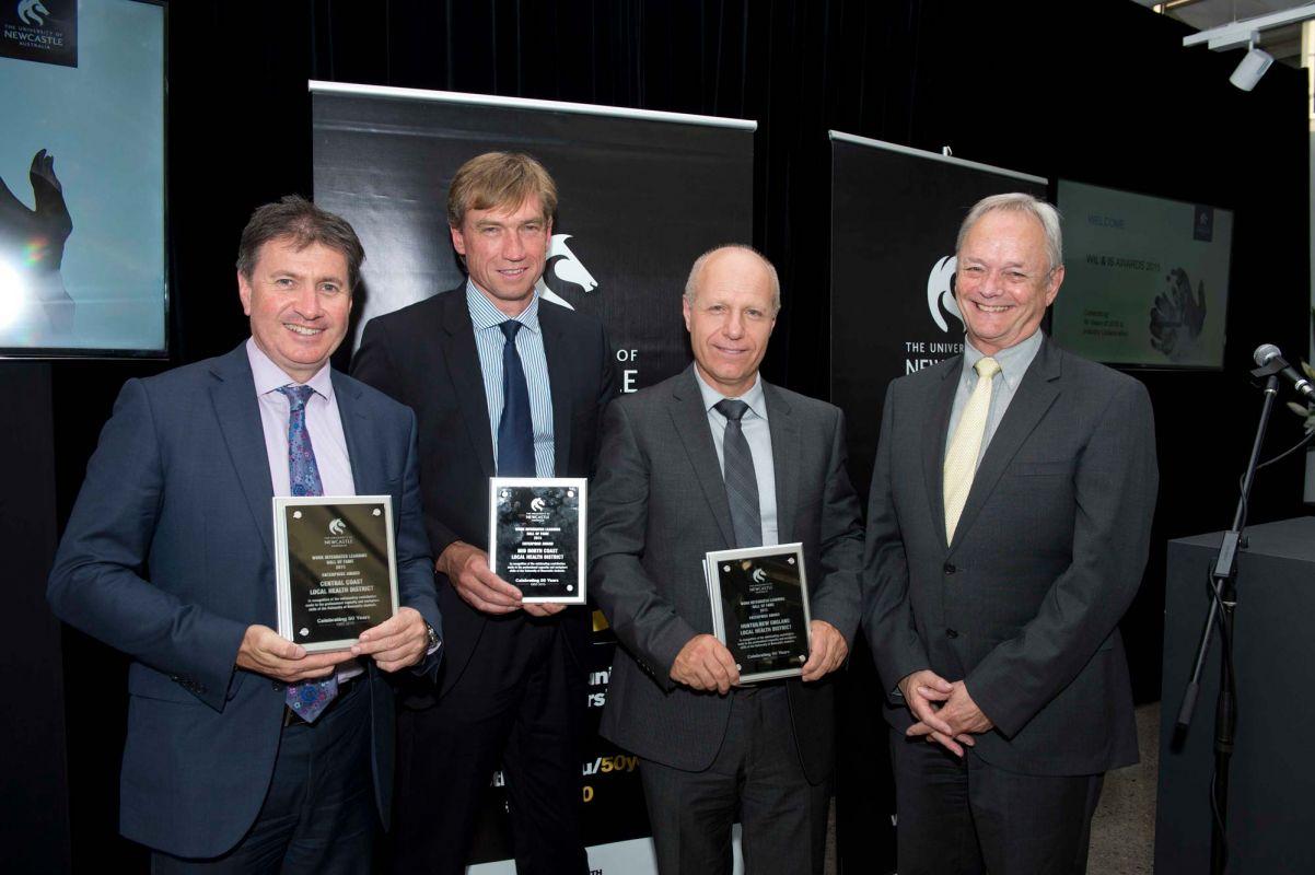 Matt Hanrahan, Stewart Dowrick, Michael Di Reinzo and John Aitken receiving awards