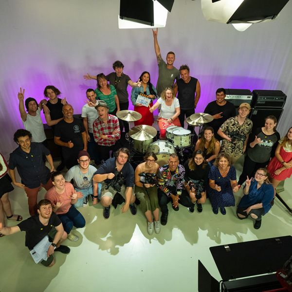 Students on set with The Living End