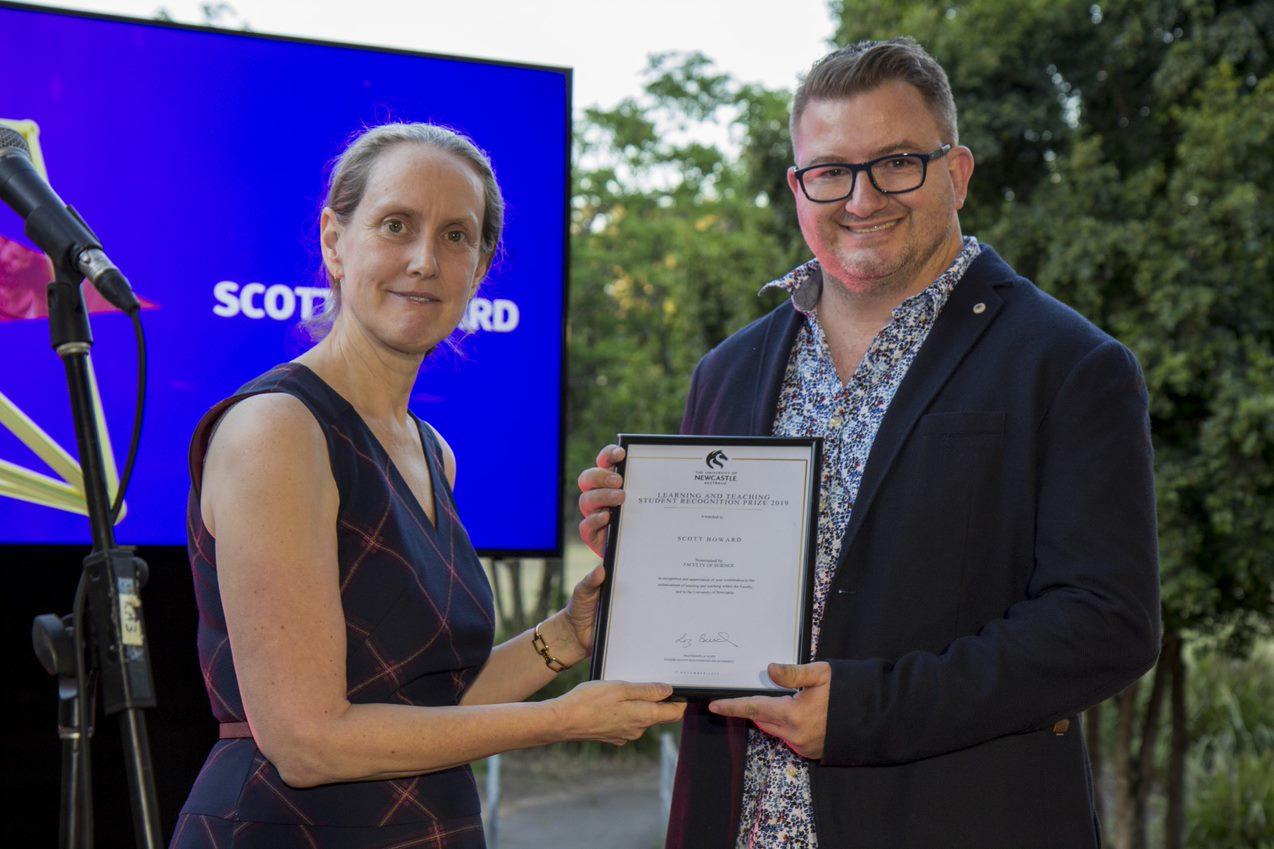 Scott Howard receiving certificate