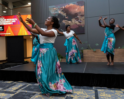 African dancers doing traditional dance on a stage at the CARE-P launch
