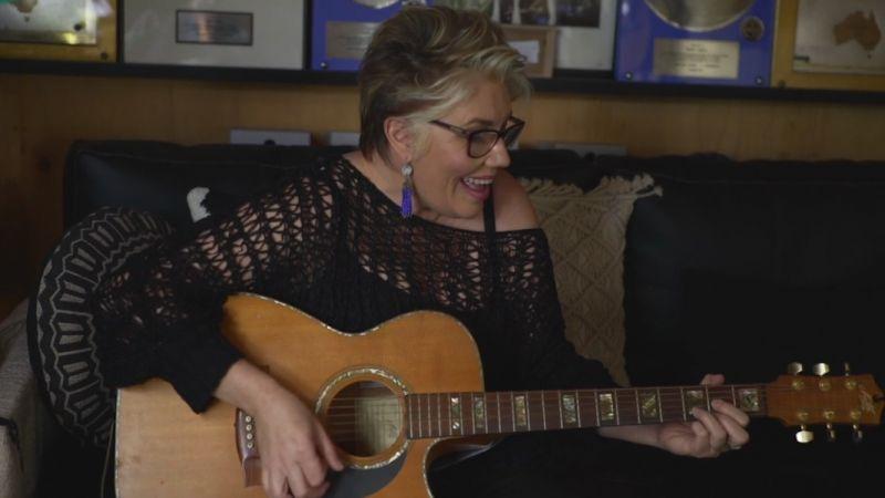 Melinda with guitar