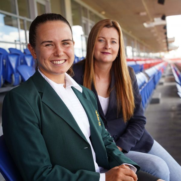 student pictured with her mentor sitting in the grand stand