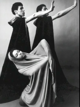 Two men and one woman posing in a performance