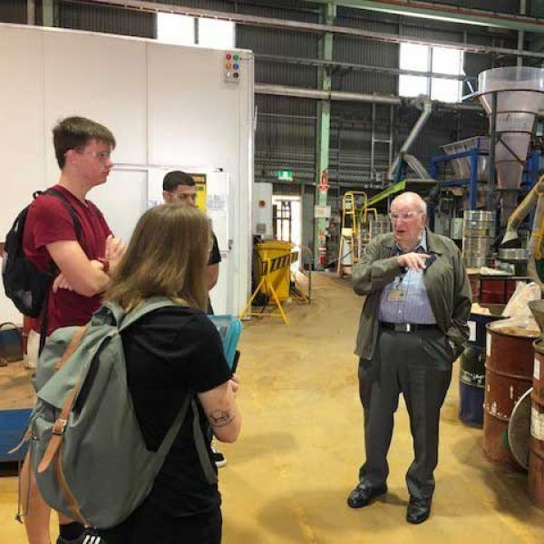 Professor Alan Roberts gives a tour of TUNRA for four recent scholarship recipients