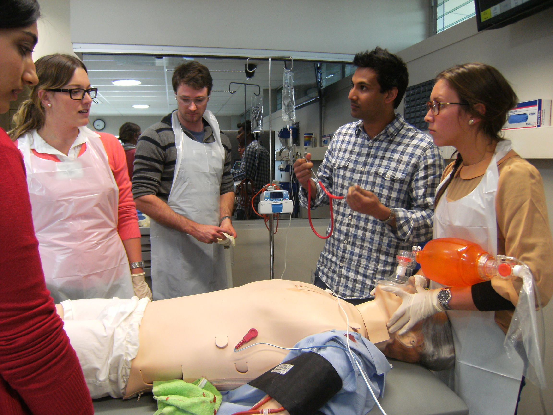 Students in a simulated trauma incident with manikin