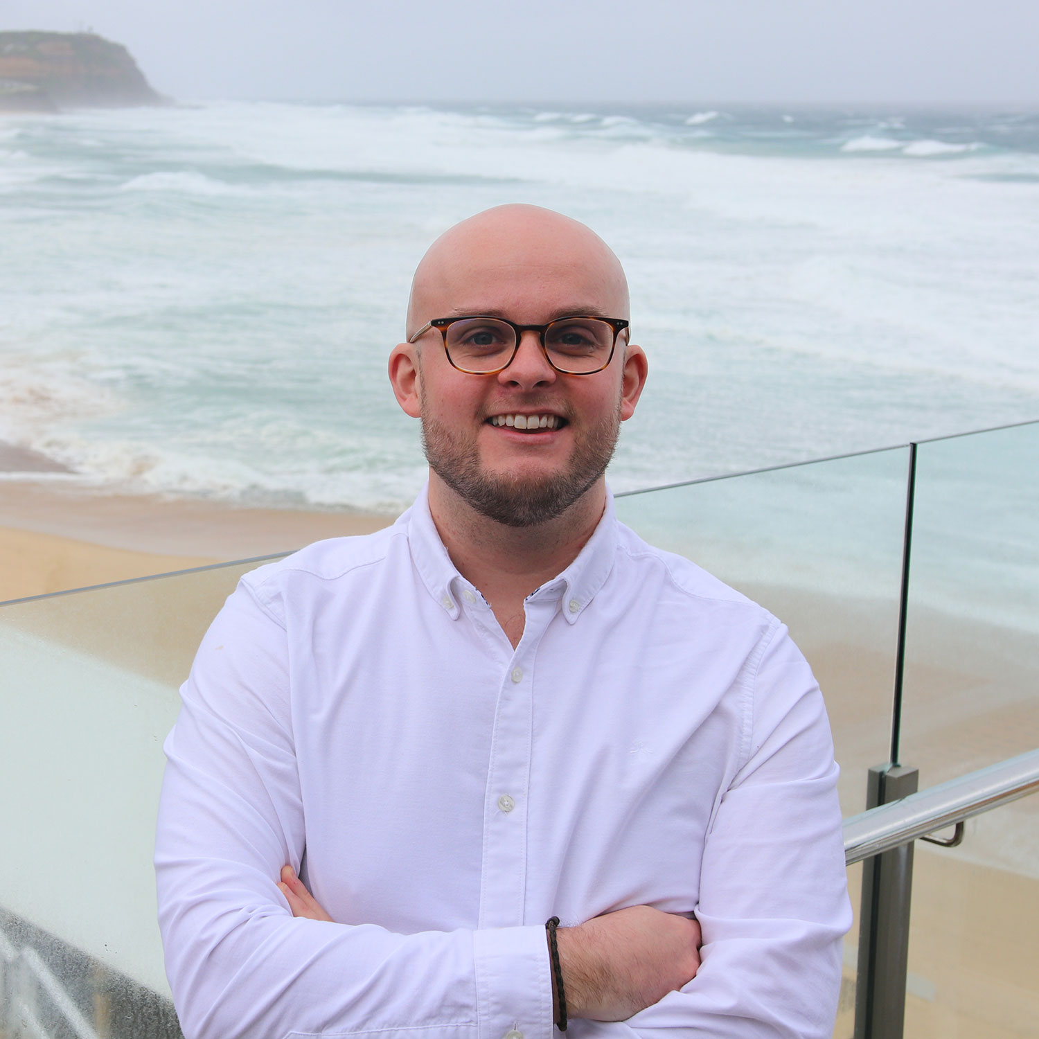 Dr Andrew Magee at the beach in Newcastle