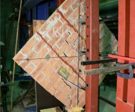 FRP retrofitted masonry panel subjected to large displacement under shear loading