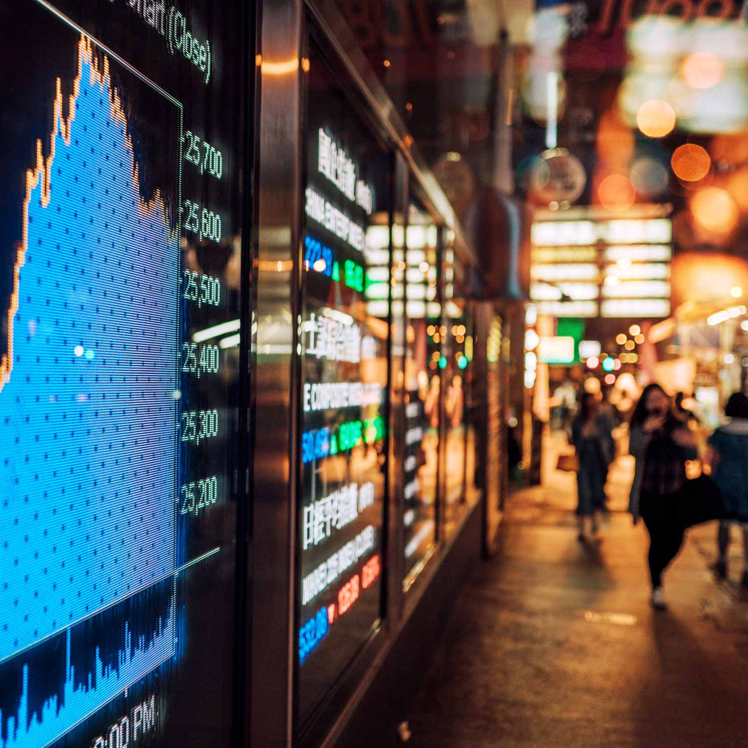 Street scape in China with screens projecting stock market