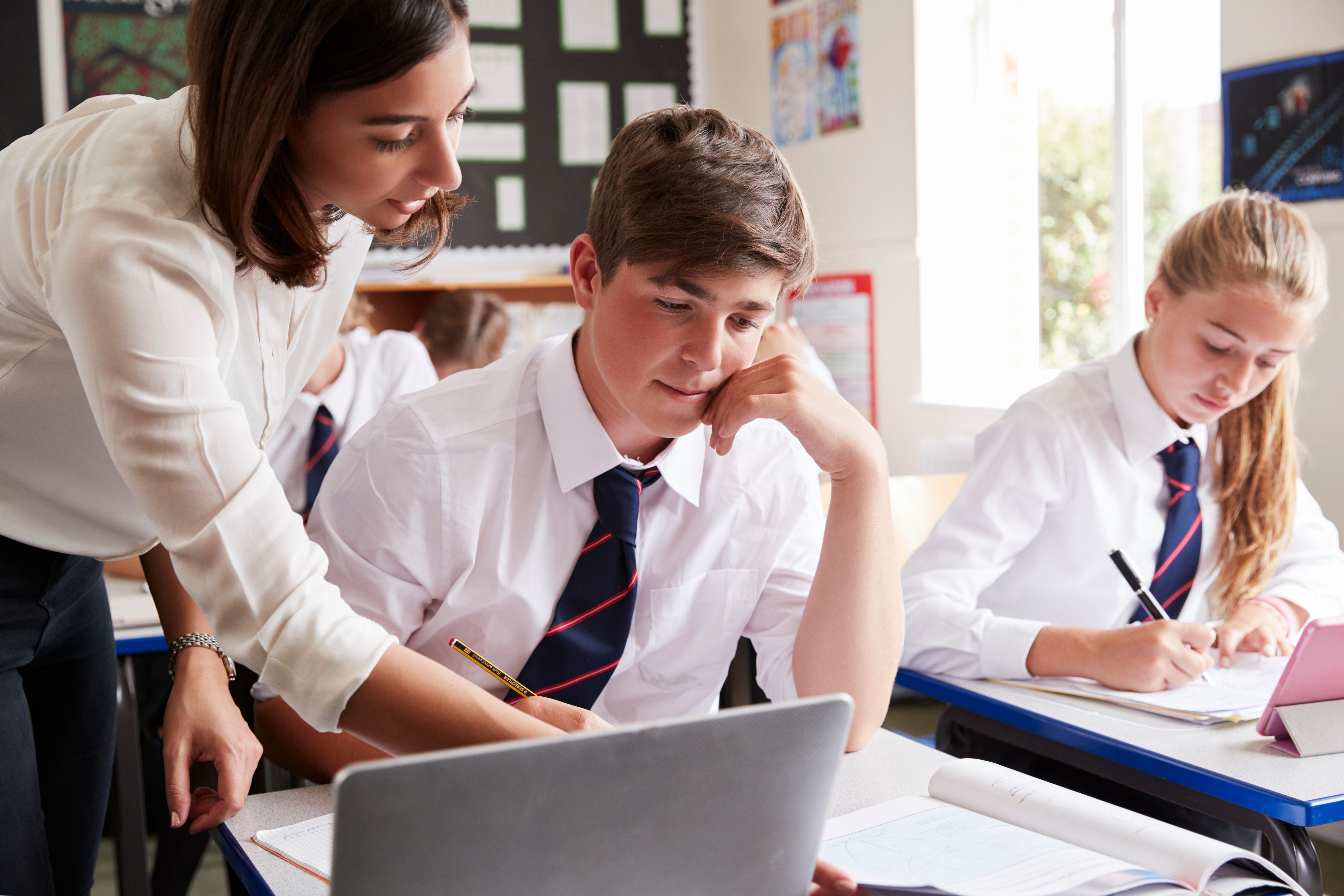 teacher helping student with their work
