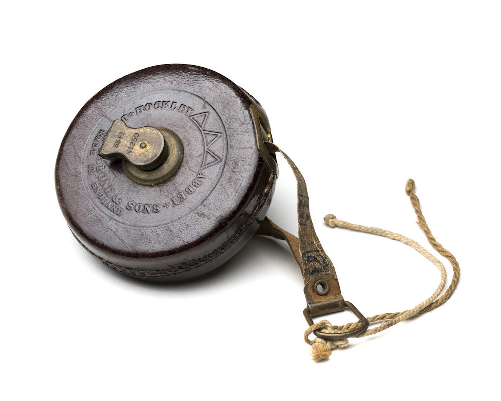 An old fashioned tape measure in a leather case