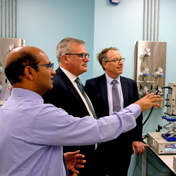 (L-R): Professor Ajayan Vinu, Vice-Chancellor Professor Alex Zelinksy AO, Chief Executive Officer of Newcastle Airport Dr Peter Cock in the nanotechnology lab