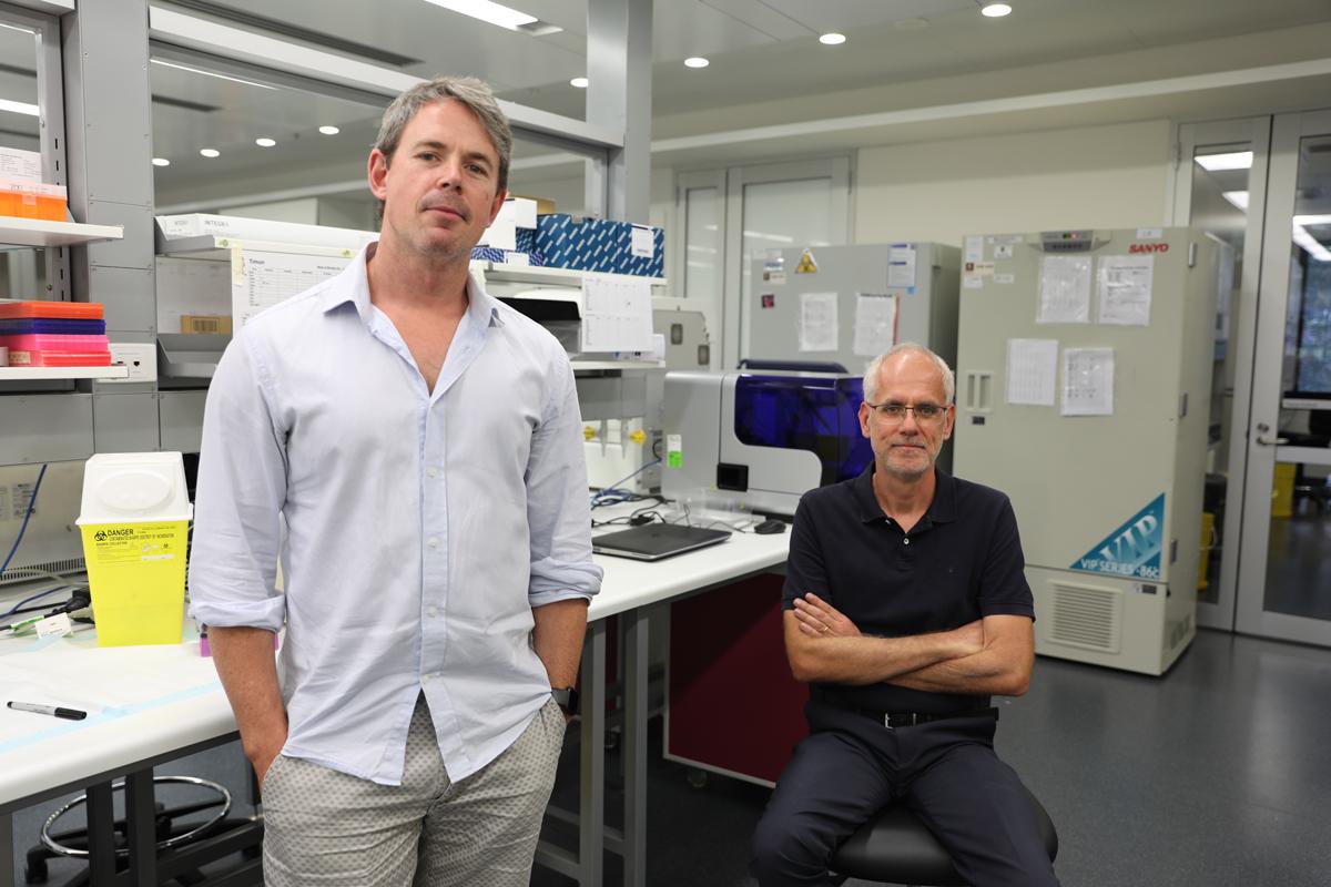 Nathan Barlett and Hubert Hondermarck in a labratory looking at the camera