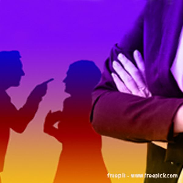 Image of people arguing and person with arms folded in a suit