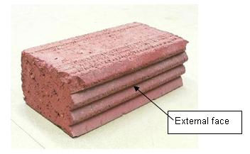 Extruded clay brick with built-in passive solar efficiency