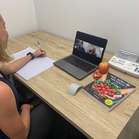 Student conducting telehealth consultation