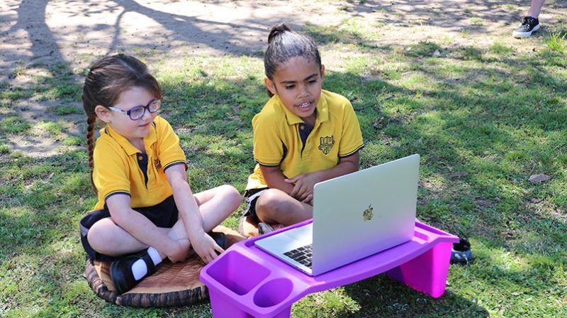 Acacia and Holly at computer