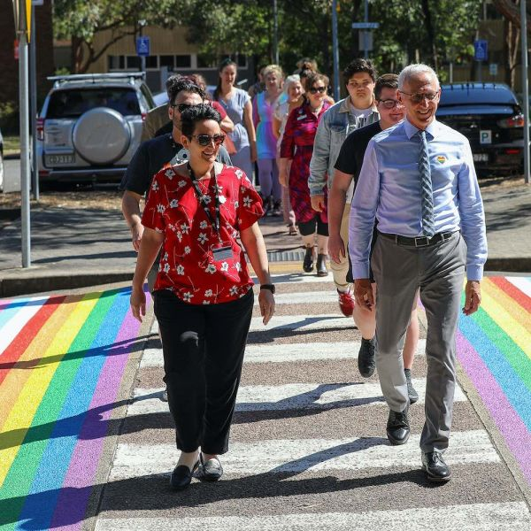 Staff and students walking the rainbow crossing
