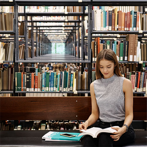 Student sitting in library