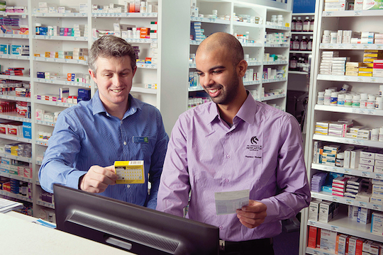 UON Pharmacy student working under supervision at UON's Pharmacy