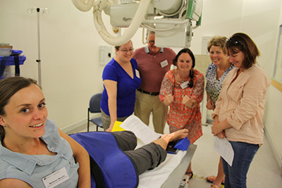 Doctors practice using the x-ray machine during the Limited Licence Radiography course
