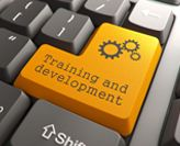 'Training and development' printed on computer keyboard