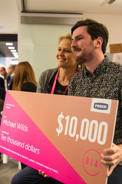 Michael Wilds receiving his prize money from judge Shaynna Blaze