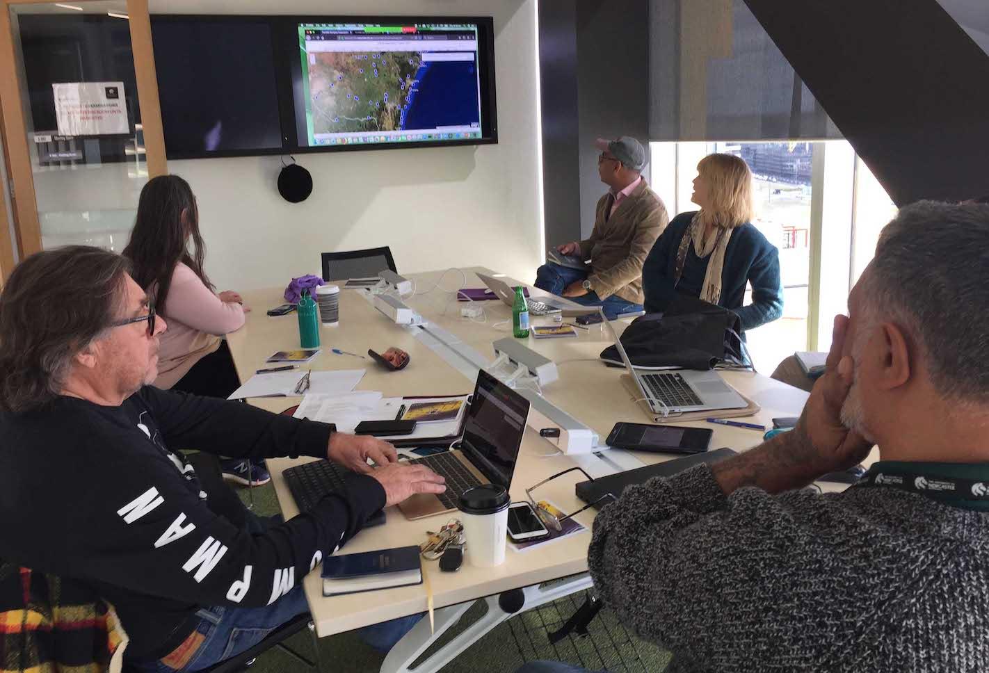 Chief Investigators looking at the digital map