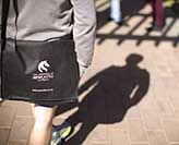 University of Newcastle logo on a satchel bag
