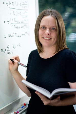 Associate Professor Sarah Johnson with mathematical equations