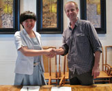 Professor Roland Boer signing contracts in Beijing with Professor Li Cuiling, director of the Centre for Studies on Socialism with Chinese Characteristics