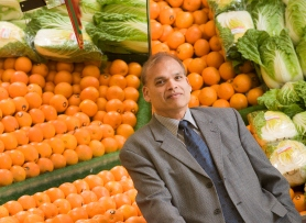 Professor Manohar Garg in the fruit shop